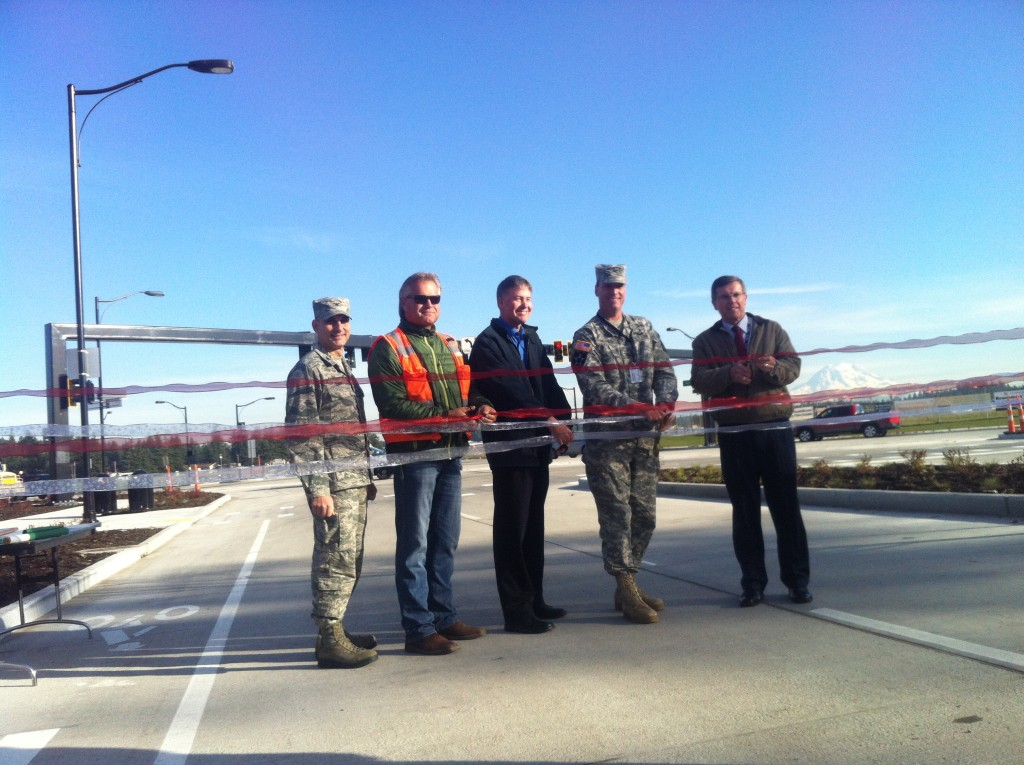 Members from the base and the design team perform a ribbon-cutting ceremony at the opening of the boulevard.